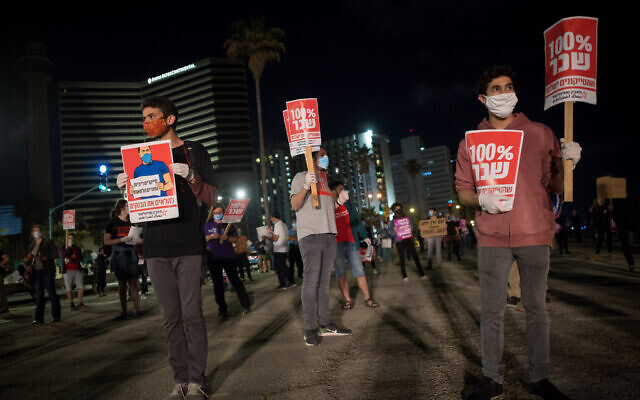 Self-employed, small business owners and activists participate in a rally calling for financial support from the government in Tel Aviv, May 2, 2020. (Miriam Alster/Flash90)