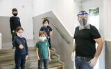 Israeli students  wear protective face masks as they return to school for the first time since the outbreak of the coronavirus, May 3, 2020 in Jerusalem. (Olivier Fitussi/Flash90)