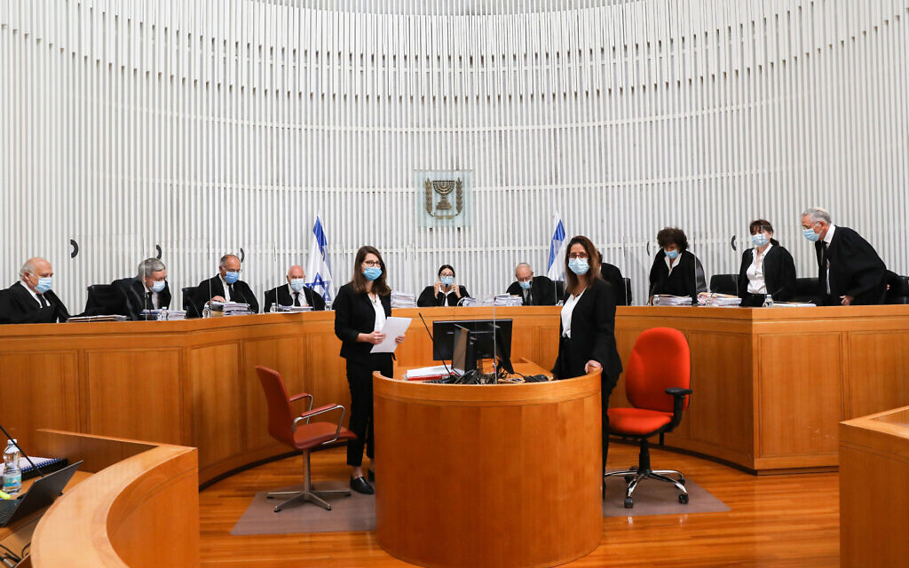 Eleven justices of the High Court of Justice attend a hearing on petitions filed against the proposed government, at the Supreme Court in Jerusalem on May 3, 2020. (Yossi Zamir/Pool)