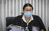 Supreme Court President Esther Hayut arrives for a court session on petitions against the coalition agreement between the Blue and White and Likud parties at the Supreme Court in Jerusalem on May 4, 2020 (Oren Ben Hakoon/POOL)
