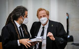 Founder of the Movement for the Quality of Government in Israel, Eliad Shraga (right) waits for Supreme court justices to enter the room for a court session on petitions against the coalition agreement, May 4, 2020 (Oren Ben Hakoon/POOL)
