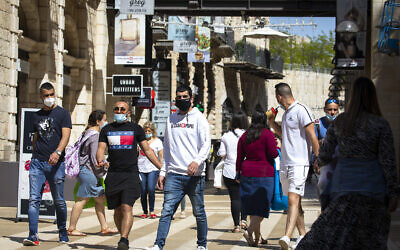 People walk and shop at the Mamilla Mall near Jerusalem's Old City on May 4, 2020. (Olivier Fitoussi/Flash90)