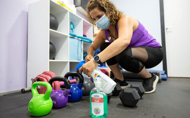 A gym teacher wears a protective face mask at the Rotem Fitness studio, In Moshav Burgata, May 6, 2020. (Chen Leopold/Flash90)