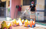 Kindergarten staff clean in the city of Modiin on May 7, 2020 (Yossi Zeliger/Flash90)