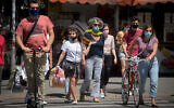 People wear protective face masks in Tel Aviv, on May 08, 2020.(Miriam Alster/FLASH90)