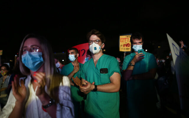 Medical interns demonstrating for better conditions at Habima Square in Tel Aviv on May 9, 2020 (Miriam Alster/Flash90)