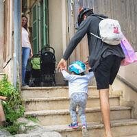 Children and their teachers as they return to kindergarten in Tel Aviv on May 10, 2020 (Avshalom Sassoni/Flash90)