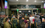 Israeli soldiers and others at the central bus station in Jerusalem on May 10, 2020. (Olivier Fitoussi/Flash90)