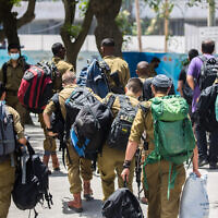 Illustrative: Israeli soldiers seen at the Central Bus Station in Jerusalem, on May 10, 2020. (Olivier Fitoussi/Flash90)