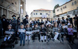 Ultra-Orthodox men and their three-years-old boys take part in a protest against the government restrictions that prevent them from reaching Mount Meron on Lag B'Omer, in the Jerusalem neighborhood of Mea Shearim on May 10, 2020 (Yonatan Sindel/Flash90)