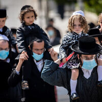 Illustrative: Ultra-Orthodox Jewish men and their children take part in a protest on May 10, 2020. (Yonatan Sindel/Flash90)