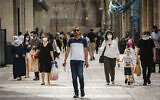 People walk and shop at the Mamilla Mall near Jerusalem's Old City on May 14, 2020. (Olivier Fitoussi/Flash90)