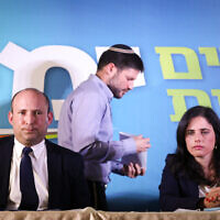 Naftali Bennett (L), Ayelet Shaked (R) and Bezalel Smotrich (C) of the Yamina party hold a press conference in Jerusalem on May 14, 2020. (Yonatan Sindel/Flash90)