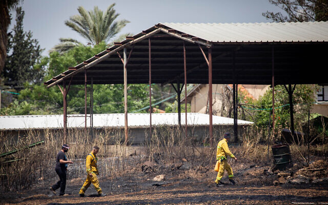 Firefighters at the scene of a blaze near Moshav Tslafon, May 16, 2020. (Yonatan Sindel/Flash90)