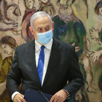 Prime Minister Benjamin Netanyahu at the Knesset after the swearing-in of the new government, May 17, 2020. (Alex Kolomoisky/Pool)