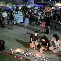Demonstrators protest against violence towards women at Habima Square in Tel Aviv, on May 18, 2020. (Tomer Neuberg/Flash90)