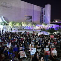 People protest against violence toward women at Habima Square in Tel Aviv, on May 18, 2020. (Tomer Neuberg/Flash90)