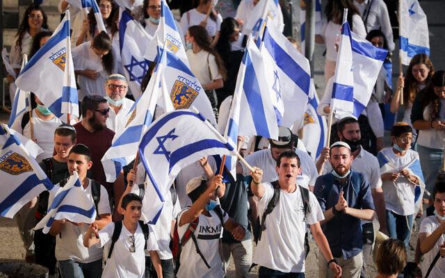 Young Jewish men celebrate Jerusalem day around the Old City walls of Jerusalem, May 21, 2020 (Yonatan Sindel/Flash90)