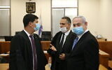 Prime Minister Benjamin Netanyahu (R) with his lawyers at the Jerusalem District Court for the start of his trial on corruption charges, May 24, 2020. (Amit Shabi/Pool/Flash90)