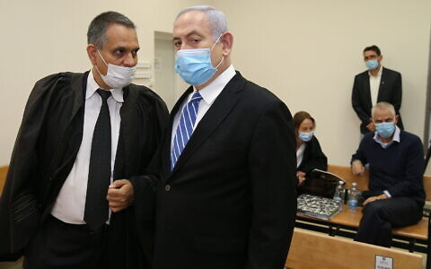 Prime Minister Benjamin Netanyahu and his lawyer Micah Fetman (L) at the Jerusalem District Court for the start of his trial on corruption charges, May 24, 2020. (Amit Shabi/Pool/Flash90)