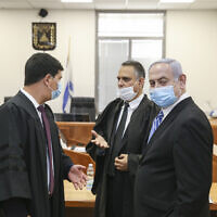 Prime Minister Benjamin Netanyahu (right) on trial at the District Court in Jerusalem on May 24, 2020. (Amit Shabi/POOL)