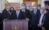 Prime Minister Benjamin Netanyahu, surrounded by Likud lawmakers, gives a televised statement before the start of his corruption trial at the Jerusalem District Court on May 24, 2020. Among the Likud ministers pictured (from left) are Amir Ohana, Miri Regev, Israel Katz, Tzachi Hangebi, Yoav Gallant and David Amsalam. (Yonatan Sindel/Flash90)