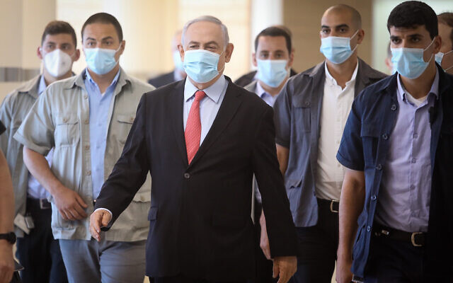 Prime Minister Benjamin Netanyahu, center, arrives for a Likud faction meeting at the Knesset, May 25, 2020. (Flash90)