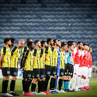 Israeli soccer returns after months of coronavirus hiatus, with a Premier League match between Beitar Jerusalem and Hapoel Beersheba at the Teddy Stadium in Jerusalem on May 30, 2020 (Flash90)