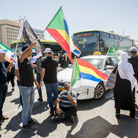 Members of the Druze community protest for the government financial support they were promised by the government, outside the weekly government office at the Ministry of Foreign Affairs in Jerusalem, May 31, 2020. (Yonatan Sindel/Flash90)