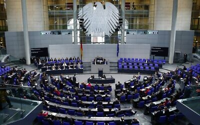 German Chancellor Angela Merkel answers the questions of deputies at Bundestag in Berlin, Germany on December 18, 2019. (Abdulhamid Hosbas/Anadolu Agency via Getty Images via JTA)
