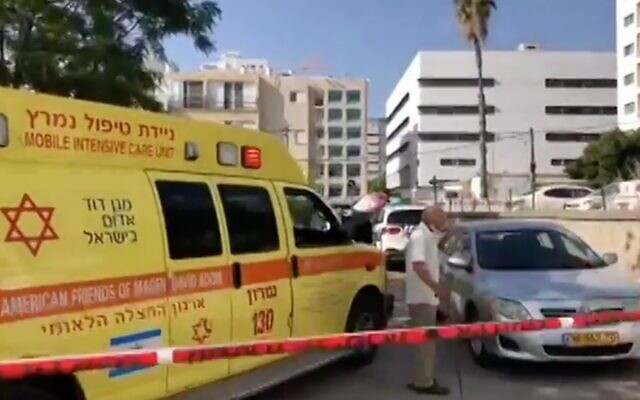 Screen capture from video of the scene in Hadera where a man was declared dead after being found unconscious in a car amid a heat wave, May 18, 2020. (Channel 12 news)