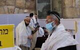 Ultra-Orthodox men pray at the Western Wall on May 21, 2020. (Sam Sokol)