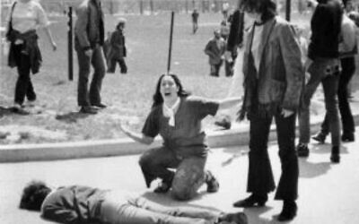 John Filo's Pulitzer Prize–winning photograph of Mary Ann Vecchio, a 14-year-old runaway, kneeling over the body of Jeffrey Miller minutes after he was fatally shot by the Ohio National Guard at Kent State University on May 4, 1970. (JTA)