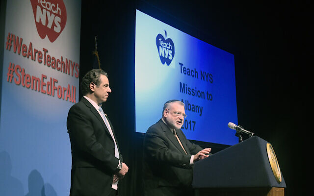 Allen Fagin, CEO of the Orthodox Union, introduces New York Gov. Andrew Cuomo on March 1, 2017, in Albany, N.Y. (Orthodox Union Photo/Hans Pennink via JTA)