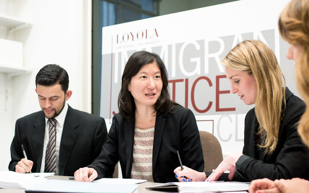 Prof. Kathleen Kim Meers with students enrolled in the Loyola Immigrant Justice Clinic. (Courtesy)