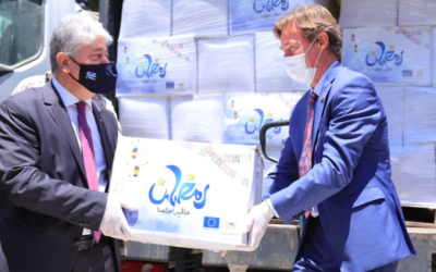 Illustrative: EU representative to the Palestinians Sven Kühn von Burgsdorff, right, hands more than 800 food packages to the PA's social development minister to be distributed to poor Palestinian families, April 30, 2020 (Facebook)