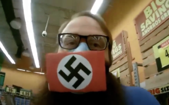 Dustin Hart wearing a swastika face mask to protest social distancing regulations. (YouTube screen-grab)