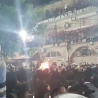 Ultra-Orthodox Israelis celebrate the Jewish holiday of Lag B'Omer in the Mea Shearim neighborhood of Jerusalem on May 11, 2020. (Screen capture/Twitter)