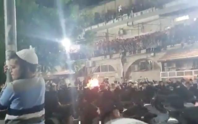 Ultra-Orthodox Israelis celebrate the Jewish holiday of Lag B'Omer in the Mea Shearim neighborhood of Jerusalem on May 11, 2020. (Screen capture/Twitter)