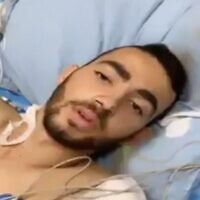 Shadi Ibrahim, an Armored Corps soldier who lost his leg in a West Bank car-ramming attack, is seen in a video from his hospital bed at Soroka Medical Center in Beersehba on May 22, 2020. (Screen capture: Channel 13 news)