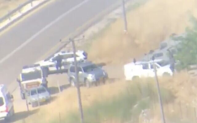 Israeli security vehicles at the scene of a suspected car-ramming attack on Israeli troops near the West Bank settlement of Halamish, May 29, 2020. (Screen capture: Twitter)