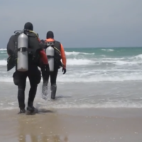 Screen capture from video of divers involved in the search for missing ballet dancer Ayman Safiah, May 26, 2020. (Israel Police)