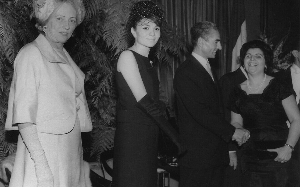 Esther Amini's mother Hana (right) shakes hands with Shah Pahlavi of Iran at a reception for the Shah and Empress Farah Diba at the Waldorf Astoria, New York, 1962. (Courtesy)