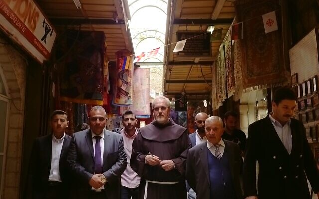 Keeper of the key Adeeb Joudeh al-Husseini (front row left) and gatekeeper Wajeeh Nuseibeh (front row second from right) on their way to open the Church of the Holy Sepulchre on Easter. (Yoram Millo)