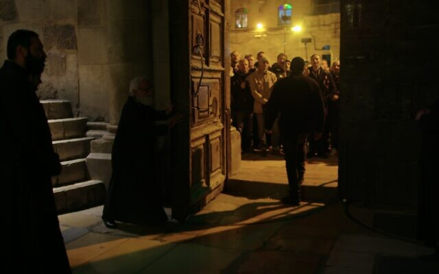 Closing the Church of the Holy Sepulchre at night. (Yoram Millo)