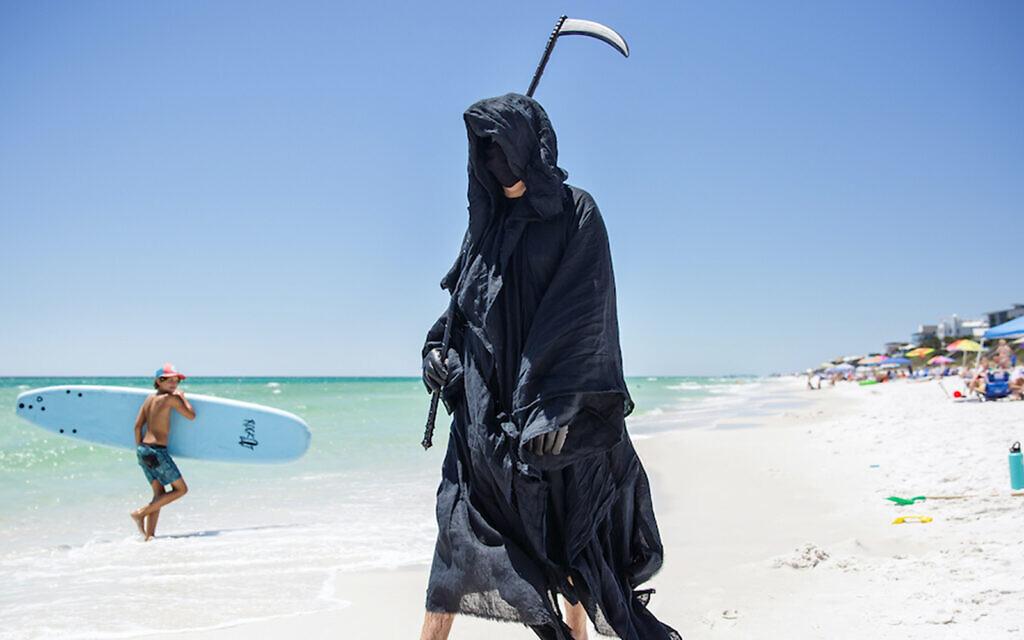 Daniel Uhlfelder protests Florida beach reopenings dressed as the Grim Reaper. (Courtesy/Daniel Uhlfelder via JTA)