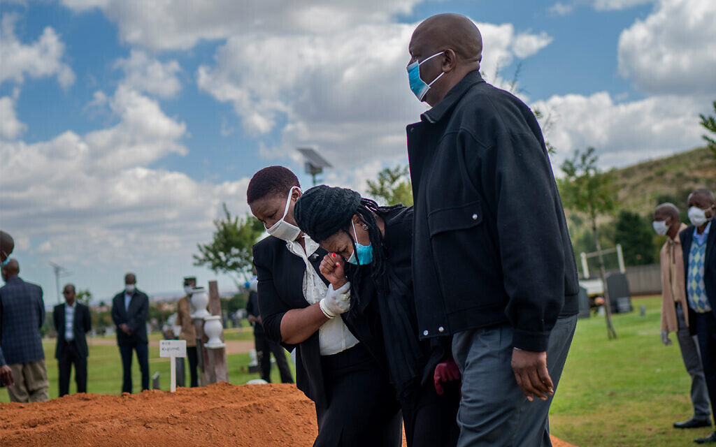 Relatives grieve a COVID-19 fatality at a burial ceremony at the Nasrec Memorial Park outside Johannesburg, South Africa, April 16, 2020. (AP/Jerome Delay, File)