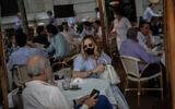 Customers at a bar terrace in Madrid, Spain, May 25, 2020. (AP/Bernat Armangue)