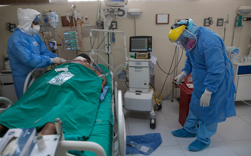 Doctors tend to a patient inside the intensive care unit for people infected with the coronavirus at a public hospital in Lima, Peru, April 30, 2020. (AP/Rodrigo Abd)