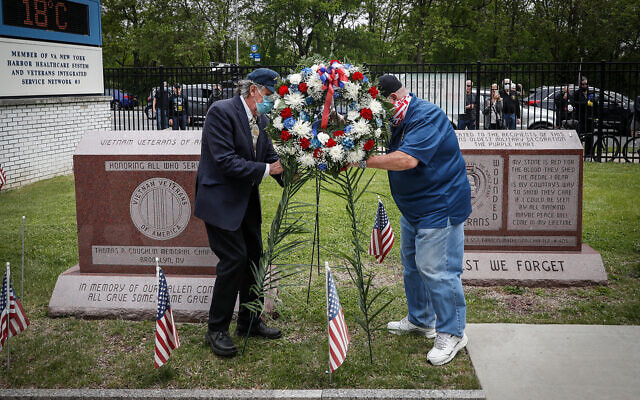 A motorcade of veterans stops outside the VA Medical Center as wreaths are placed beside memorial stones on the premises in Brooklyn, New York, May 25, 2020. (AP/John Minchillo)